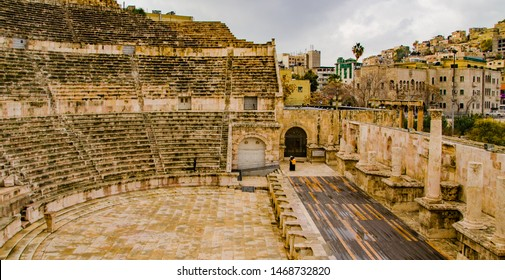 Amman, Jordan, February 27, 2019 View at the roman amphitheater in Amman, Jordan with heavy clouds of coming rain