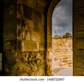 Amman, Jordan, February 27, 2019 View at the roman amphitheater in Amman, Jordan with heavy clouds of coming stormy rain