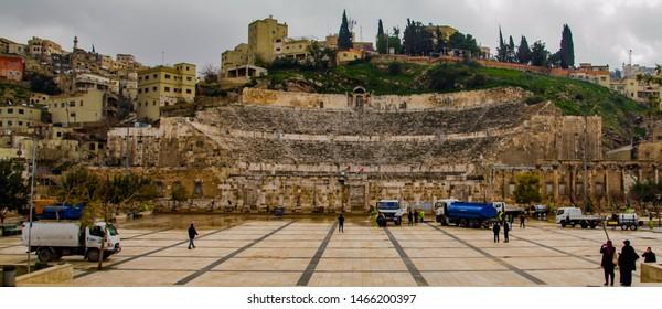 Amman, Jordan, March 1, 2019 Emergency pump services pumping water at Amman Roman Theater Amphitheater after heavy rain flooded ground