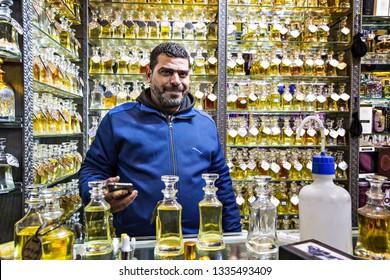 AMMAN, JORDAN - March 2019: Man selling traditional Arabic parfumes bottles on the market in Amman, Jordan