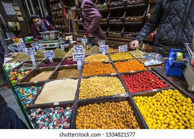 AMMAN, JORDAN - March 2019: Spices, nuts and sweets shop on the market in Amman downtown, Jordan
