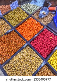 AMMAN, JORDAN - March 2019: Spices, nuts and sweets shop on the market in Amman downtown, Jordan. Choice of Arabic spices on the Middle East bazaar, Jordan