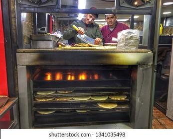 AMMAN, JORDAN - March 2019: Jordan street food, local men cooking traditional arabic food on the big oven, Amman, Jordan