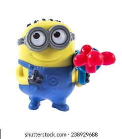 Amman, Jordan - November  1, 2014: Minion Stuart Blaster toy figure. There are plastic toy sold as part of the McDonald's Happy meals.