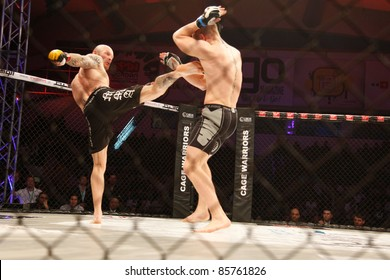AMMAN, JORDAN - SEPTEMBER 8 : Conor Mcgregor (Right) defeats Aron Jahnsen (Left) by Knockout at 3:29 of Round 1, Cage Warriors Fight Night 2, Fight Card on September 8, 2011 in Amman, Jordan