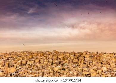 Amman, Jordan, view of the old city, a large complex of decaying buildings overlooking the citadel located on Jabal Al Qal'a. Kites in the sky.