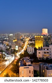 Amman,Jordan - April 29 : City lights after the sunset on April 29,2013 in the west side of Amman and Le Royal hotel with in the background