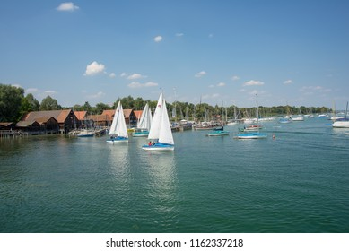 Ammeersee,Germany-August 20,2018: Boats sail lazily on light winds on Ammersee lake
