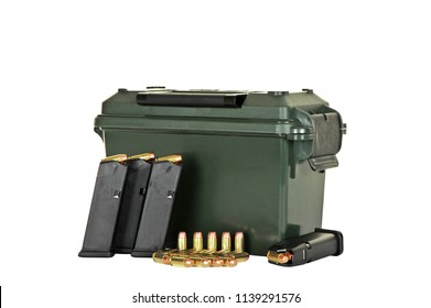 Ammo Box and Four Loaded High Capacity Handgun Magazines with Extra Bullets isolated on WHite Background