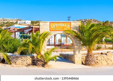 AMMOPI VILLAGE, KARPATHOS ISLAND - SEP 26, 2018: View of taverna restaurant and white houses in small village on coast of Karpathos island, Greece.