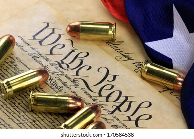 Ammunition and American flag on US Constitution - History of the Second Amendment