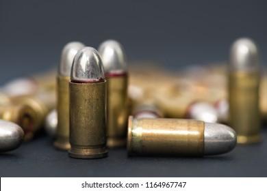 ammunition bullets , dark grey backround