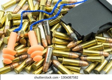 Ammunition earplugs and gun magazine on white background. Bullets on white background. A group of  bullets for a gun isolated on white background.