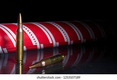 Ammunition on a dark background with Christmas wrapping paper behind