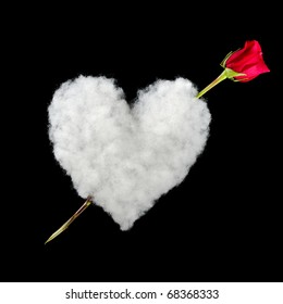 Amor: White heart out of cotton with red rose as arrow photographed on black