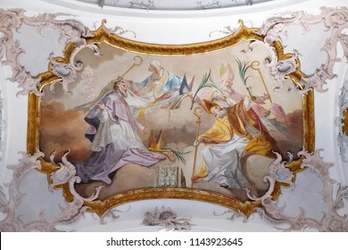 AMORBACH, GERMANY - JULY 08, 2017: Amorbach abbots and bishops of Verden and Martyrs: Saint Tanco, Kortyla, Haruchus and Erlulphus fresco by Matthaus Gunther in Benedictine church in Amorbach, Germany