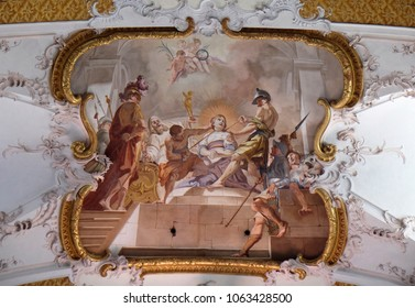 AMORBACH, GERMANY - JULY 08: The martyrdom of St. Beatrix fresco by Matthaus Gunther in Benedictine monastery church in Amorbach, Germany on July 08, 2017.