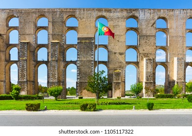 Amoreira Aqueduct and flag of Portugal in Elvas. Alentejo, Portugal.