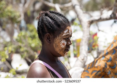 AMORONIA ORANGE COAST , MADAGASCAR, OCTOBER 29.2016,  Aboriginal girls decorate their faces, Amoronia orange coast, Madagascar,  October 29. 2016,