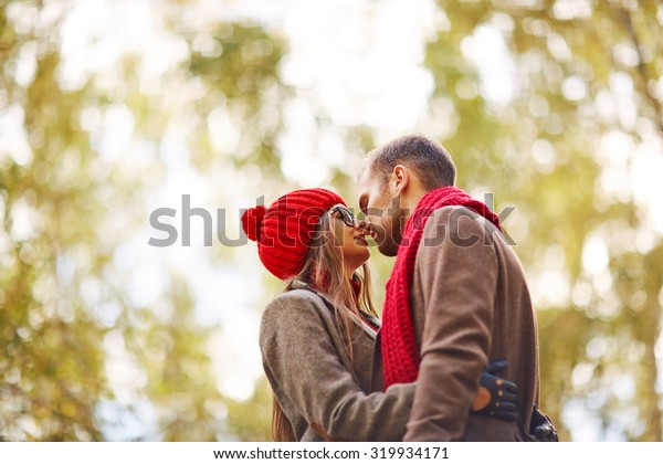 Amorous couple embracing in park