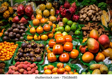 A lot amount of fruits and vegetables in market place.