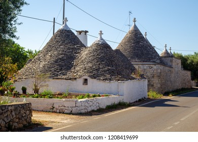 amous Trulli, the characteristic cone-roofed houses of the Itria Valley, Apulia, Southern Italy.