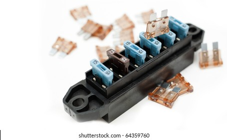 amp rated car fuses inserted in fuse box