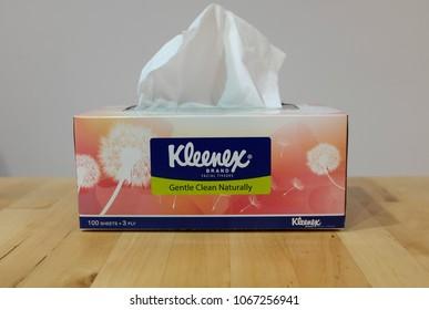 Ampang, Kuala Lumpur - April 12, 2018 : Photo taken of a box of Kleenex on wooden surface & white background