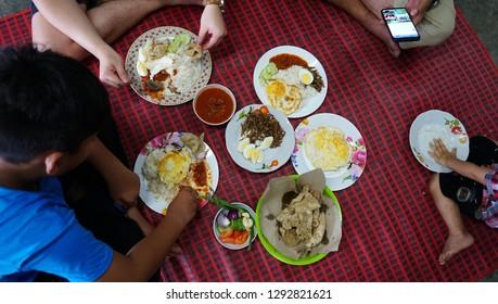 Sunday, 6 January, 2019, 11:06:04 AM ampang, kuala lumpur, group people eating nasi lemak with tradisional style