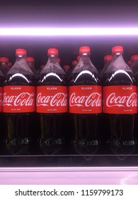 AMPANG, MALAYSIA - AUGUST 20, 2018: Coca-Cola Klasik carbonated soft drinks in bottles of 1.5 liter for Malaysia market with vivid neon lighting in the supermarket shelves.