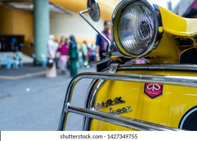 Ampang, Selangor/Malaysia-June 18th 2019: A mint condition classic yellow Italian-made scooter, the VESPA, which has been in production since 1940s on display.  VESPA is owned by Piaggio, Italy.