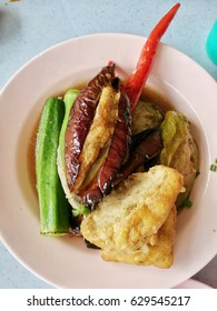 Ampang yong tau foo is a Hakka Chinese food consist of tofu eggplant chilli ladies finger okra filled with either a ground meat mixture or fish paste and deep fried and served with sweet bean sauce