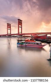 Ampera Bridge of Musi River, Palembang Buffeted by the Light of the Setting Sun