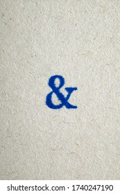 a ampersand symbol stamped on a piece of paper.