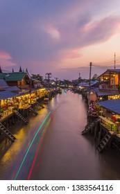 Amphawa district,Samut Songkhram Province,Thailand on April 12,2019:Amphawa Floating Market with beutiful twilight sky