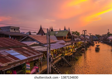 Amphawa district,Samut Songkhram Province,Thailand on April 12,2019:Amphawa Floating Market with beautiful sunset sky