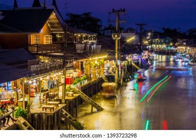 Amphawa district,Samut Songkhram Province,Thailand on April 12,2019:Amphawa Floating Market with beautiful twilight sky