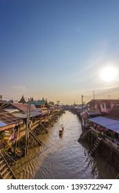 Amphawa district,Samut Songkhram,Thailand on April 12,2019:Evening sun at Amphawa Floating Market.