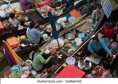 Amphawa Floating Market - December 21, 2012: The most famous floating market in Thailand sees as variety of Thai Traditional Food.