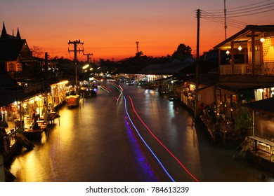 Amphawa Floating Market is popular for tourists who love nature and lifestyle. Sunset at Amphawa, Thailand