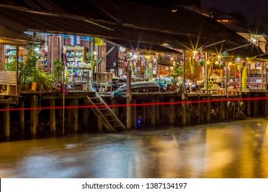 Amphawa Floating Market,Samut Songkhram Province,Thailand on April 12,2019:Homestays along Amphawa canal at night