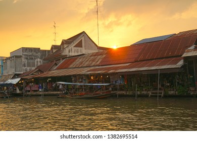 Amphawa Samut Songkhram Thailand - December 9,2018 :  Traditional thai house and boat tour on the Amphawa Floating Market river at Amphawa Samut Songkhram Thailand