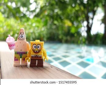 Amphawa, Thailand - 16 July 2019 - Lego Spongebob and Patrick mini figures enjoy summer time at the pool.