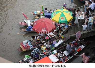 Amphawa, Thailand - May 4 2019: Amphawa floating Market is the most famous floating market and cultural tourist destination in Thailand. It is about 110 km from Bangkok,.