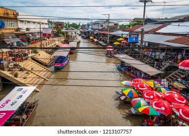 Amphawa, Thailand - Sep 13, 2015: Floating food market at Amphawa where food is cooked and prepared on the boats and serve to the people on the river canal bank