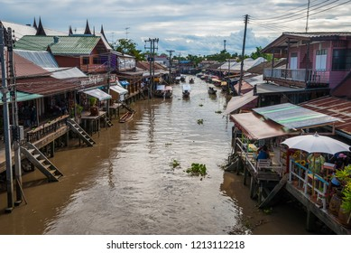 Amphawa, Thailand - Sep 13, 2015: Main canal of Amphawa floating food market, full of boats and small restaurants