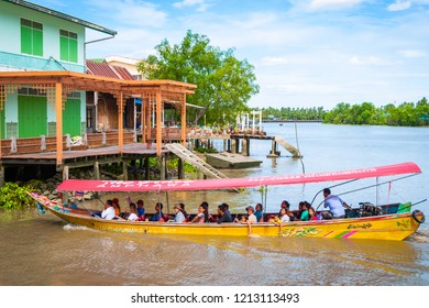 Amphawa, Thailand - Sep 13, 2015: Tourist boat transporting visitors to Amphawa floating market, parked at water canal