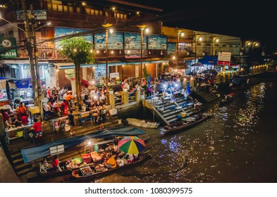 AMPHAWA,THAILAND - APRIL 6,2018: Amphawa floating Market at night, the most famous floating market and cultural tourist destination.