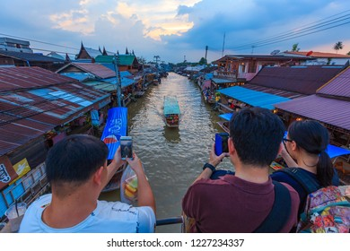 AMPHAWA,THAILAND - October 28,2018: Amphawa floating Market at afternoon, the most famous floating market and cultural tourist destination.