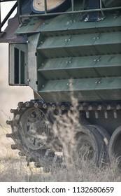 Amphibious tank caterpillars are seen on a war field
